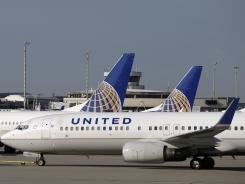 A United Airlines jet pushes back from a gate at Cleveland Hopkins Airport International Airport in July 2012.