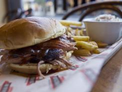 Regional barbecue chain Jim 'N Nicks still hickory-smokes its meat and makes everything from scratch. Diners often gravitate toward the pulled-pork sandwich.