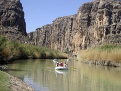 Rafts emerge from Heath Canyon, carved by the Rio Grande through Big Bend National Park, Texas.