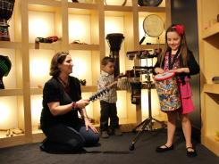 Families enjoy experiencing over 150 instruments in the Rhythm! Discovery Center's Interactive Area in Indianapolis.