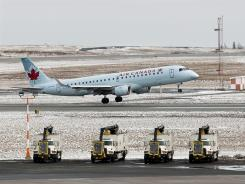An Air Canada jet takes off from Halifax Stanfield International Airport in Enfield, Nova Scotia, on March 7.