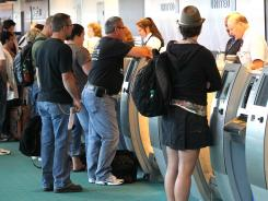 Airlines' customer base: Travelers gather at the ticket counter at Portland International Airport in Portland, Ore., on May 25.