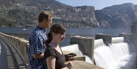 Environmental Defense analyst Spreck Rosekrans, left, and fellow analyst Ann H. Hayden look over O'Shaughnessy Dam and Hetch Hetchy reservoir near Yosemite National Park, Calif.