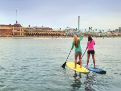While most people associate Santa Cruz, Calif., with surfing, stand-up paddle boarders are hitting the Pacific waters too.