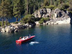 Boaters at Emerald Bay State Park pull up to Lake Tahoe's only island, Fannette Island. Weekends at 'Big Blue' can draw 150,000 visitors.