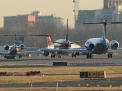 Planes taxi at Ronald Reagan National Airport in Washington.