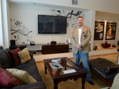 James Griffin of Tampa stands in the living room of his condo in the city's downtown. Griffin is asking $1,250 a night to rent his home for the Republican National Convention.