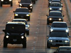 People drive on the Ventura Freeway at the end of the evening rush hour in Glendale, Calif., before the start of the Labor Day holiday weekend in 2010.