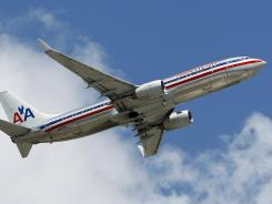 An American Airlines jet takes off from Miami International.