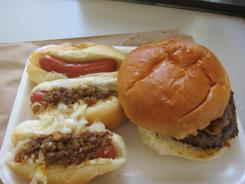 Hot Dog Charlie's: Three mini-dogs, two with works and one plain, plus a burger with meat sauce and onion.