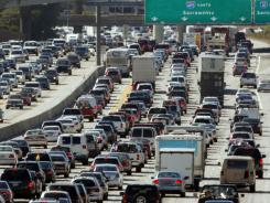 Holiday travelers mix with rush-hour commuters on Interstate 405 near Los Angeles in this file photo.