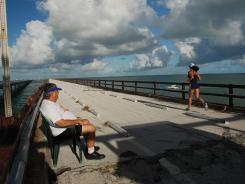 Norm Dille, left, usually includes a trip to the old Seven Mile Bridge to take in the views as a part of his morning ritual. A nonprofit community group was formed last summer to try to rescue the bridge.
