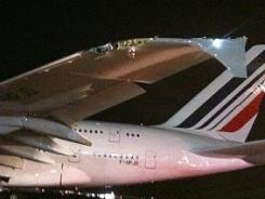 A damaged Airbus A380 belonging to Air France sits on the runway at John F. Kennedy International Airport, on April 12, 2011, after it clipped a much smaller Bombardier CRJ-700 on a wet tarmac.