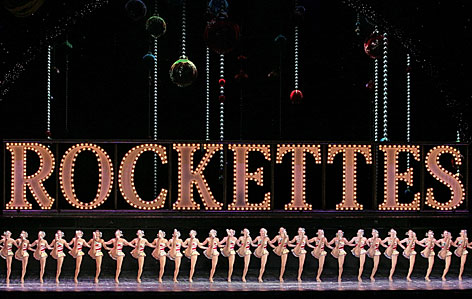 "The Radio City Rockettes perform in the annual ""Radio City Christmas Spectacular,"" marking its 75th year in New York.   In the 1951 publication of ""The Catcher in the Rye,"" its main character Holden Caulfield wanders around Manhattan at Christmastime visiting key landmarks,  including Radio City and the Rockettes."