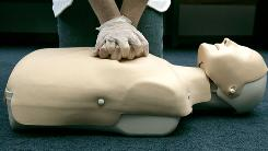 "A person participates in an American Red Cross CPR training in Washington. ""Hands-only"" CPR (skipping ""mouth-to-mouth"") can still save lives, studies find."