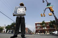 Joseph Moore, 80, carries a fan donated by the Comcast-Spectacor Foundation and distributed at the Philadelphia Senior Center in Philadelphia, July 7. The elderly are particularly vulnerable to high termperatures.