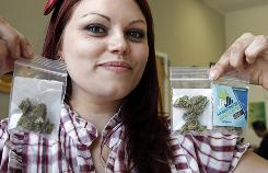 "Dani Geen holds 1 1/2 gram ""care packages"" of medical marijuana at the Harborside Health Center in Oakland, Calif., where, until recently, the center had a program that gave out free weekly ""care packages"" to about 600 patients on unemployment or pensions."