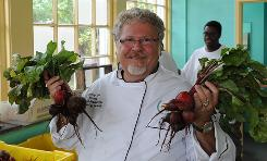 Director of food and nutrition for Baltimore City Schools, chef Tony Geraci shows off some of the beets grown at the school district's Great Kids Farm.
