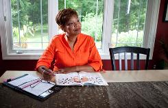 Cheryl Edwards-Cannon sits in her Belmont, Mich., home working on crosswords puzzles. She is concerned with keeping her brain sharp as she ages. Puzzles and brain games, however, just make you better at that particular exercise, says psychology professor Mark McDaniel, it doesn't improve overall memory.