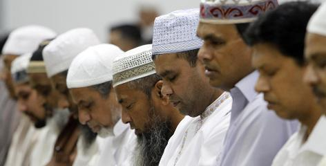 Muslim men pray at the Darul Uloom Institute in Pembroke Pines, Fla., on Aug. 11, the first day of Ramadan. Muslims across the world refrain from eating, drinking and smoking from dawn to dusk during the holy month.