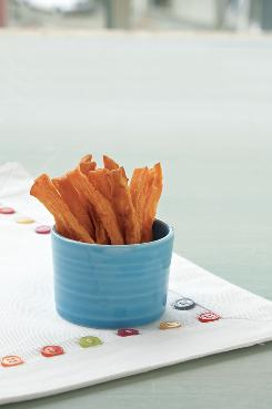 Baked sweet potato fries is one of the recipes in 'Love In Spoonfuls' from the editors of 'Parenting,' published by Chronicle Books.