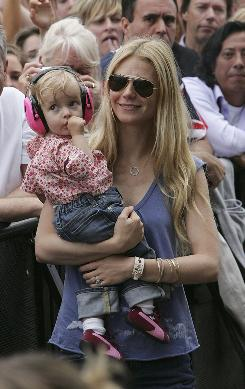 Actress Gwyneth Paltrow's daughter Apple wears headphones to protect her ears at her father Chris Martin's Coldplay concert in London in 2005. Perhaps more kids should follow her lead and use earplugs at concerts, since hearing loss is up in teens.