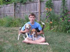 Sam Casadevall holds beagles Sandy, left, and Rudy. His family adopted Rudy from a shelter, but he chose the name  after the inspiring football movie.