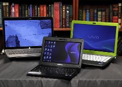 Different brands of laptop computers are shown in New York. Students who use laptops should be on the lookout for headaches, wrist pain, tingling in the fingers and neck or shoulder pain