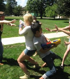"Like a ""massive game of tag"": Students Caitlin Davis and Brendan Killian play Humans vs. Zombies during Goucher College's 2009 spring game."