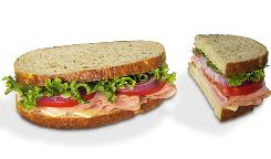 Panera's smoked ham and Swiss sandwich, left, weighs in at 14 oz., 700 calories, while the USDA portion, 5 oz., right, carries 250 calories.