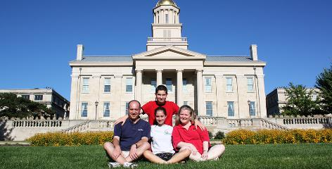 The Kramer family, with Ariana, center, her brother Chase, above and her parents Paul and Robin sit in front of the Old Capitol Museum, an iconic building at the University of Iowa. Ariana, 18, is one of many college freshmen who are saying goodbye to parents -- a process that college administrators say is becoming more difficult.