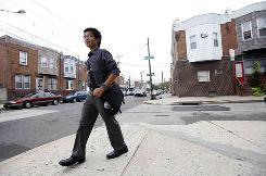 Duong Nghe Ly from his home in Philadelphia to a subway stop en route to a summer internship. A &quot;riot&quot; at his school last year changed his life, he says.
