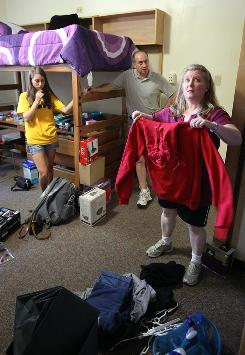 Paul and Robin Kramer of Chicago help their daughter Ariana move into her dorm room at the University of Iowa in Iowa City.