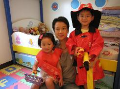 Noelle Leung (no relation to Nicole) with daughter Chloe Chau, 3, and son Colin Chau, 5. Like many modern women, Leung altered the confinement rules. She took showers and washed her hair, but did so quickly. She stayed in for the first week or two, then ventured out in moderation.