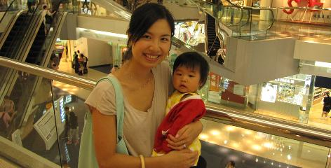 """Nicole Leung holds her daughter Valerie. For Leung, the appeal of confinement after her children, Adrien, 4, and Valerie, 1, were born was the belief that """"if you eat well and take care of yourself, your body will be even healthier than before (giving) birth,"""" she says. """"It's only a month."""""""