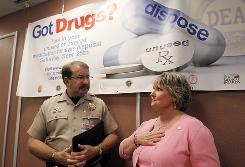 Director of the Arizona Department of Public Safety Robert Halliday, left, talks with Kim O'Bert, who lost her son to a prescription drug overdose, after a news conference announcing a first-ever statewide prescription drug take-back day campaign, Sept. 22 in Phoenix.