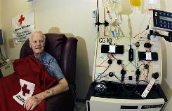 Bob Svensson is hooked up to a blood infusion machine at the American Red Cross in Dedham, Mass., as he undergoes a $93,000 prostate cancer treatment.