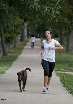 Kim Goedeker of St. Louis didn't start running until she got her dog Lola several years ago. Now they run daily.