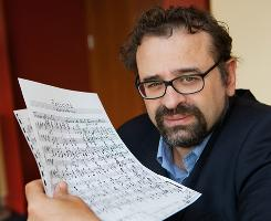 Francesco Lotoro holds sheet music at Emory University's Schwartz Center in Atlanta on Sept. 27. Lotoro has collected more than 4,000 musical compositions written in Nazi concentration camps.