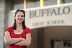 Suzanne Feldman, 21, who wants to teach math, stands in front of her old high school in Buffalo, Mo.