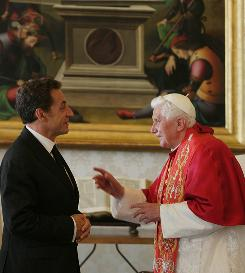 Pope Benedict XVI chats with French President Nicolas Sarkozy at his private library on Oct. 8 in the Vatican.