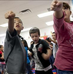 On your feet: Lucio Chavez, 6, left, Kody Jones, 6, and Reyna Gutierrez, 6, keep the beat.