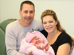 Chad and Barbie Soper hold their baby Cearra Nicole, who was born Oct. 10, 2010.