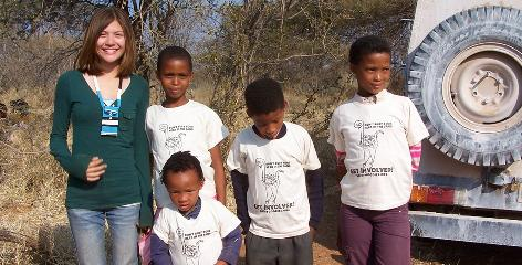 Macallan Durkin, founder of Goody Goodies, gives away T-Shirts to San Bushmen school children in Ghanzi, Botswana.