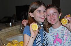 "Lulu Cerone, 10, left, LemonAID Warriors founder and volunteer Emily Rahhal, 11, prepare homemade lemonade for Lulu's ""Boys Vs. Girls LemonAID War"" to benefit Haiti."