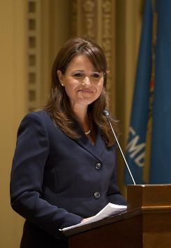 Delaware Republican Senate candidate Christine O'Donnell answers a question during a Rotary Club debate against opponent Democratic Chris Coons in Wilmington, Del., Oct. 14.