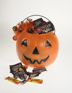 Need help avoiding Halloween candy calories? Don't buy one of your favorites to give to trick-or-treaters, suggests dietitian Bonnie Taub-Dix.