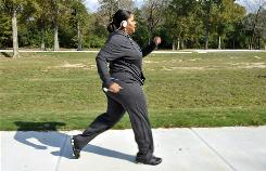 Deidra Atkins-Ball, 44, walks in Forest Park in Baton Rouge, Nov. 23. Atkins-Ball has diabetes and took part in a study where she was in a nine-month fitness program combining aerobics and weight training. She successfully lowered her blood sugar levels.