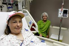 Heather Hall, left, and Michelle Summers at Georgetown University Hospital in Washington, Nov. 22. Heather's mother Melodie Myrick gave a kidney several years ago, and Heather's Aunt Michelle, gave a kidney recently so Heather could receive a new kidney.