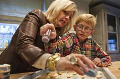 Stephen Smith, 11, and his mother Kathryn bake cookies Nov. 18 in Houston. Smith hosts a party every year to gather toys for the needy.